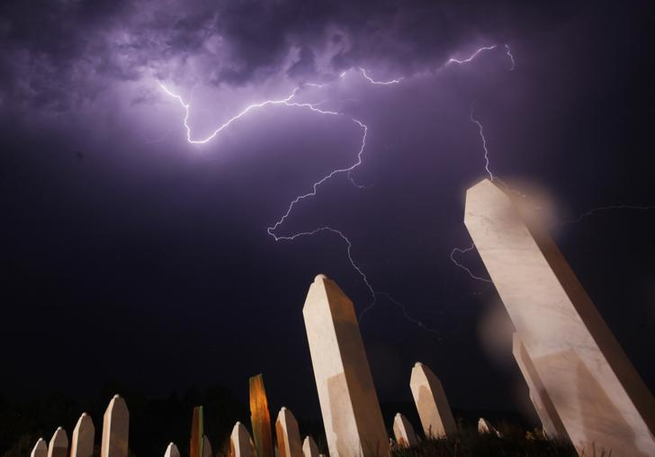 Lightning is seen during a storm under the Memorial Center in Potocari the night before a mass burial